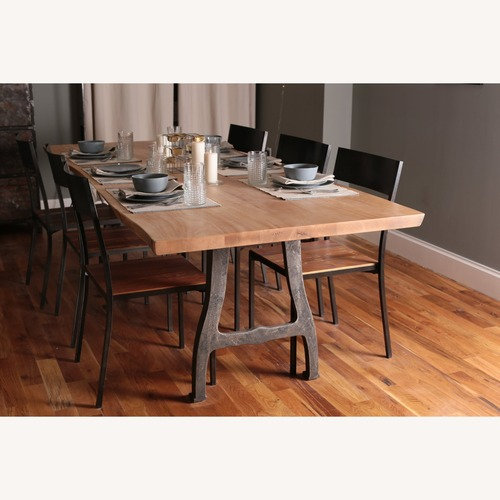 Used Solid Exotic Wood Dining Table with Cast Iron Legs for sale on AptDeco