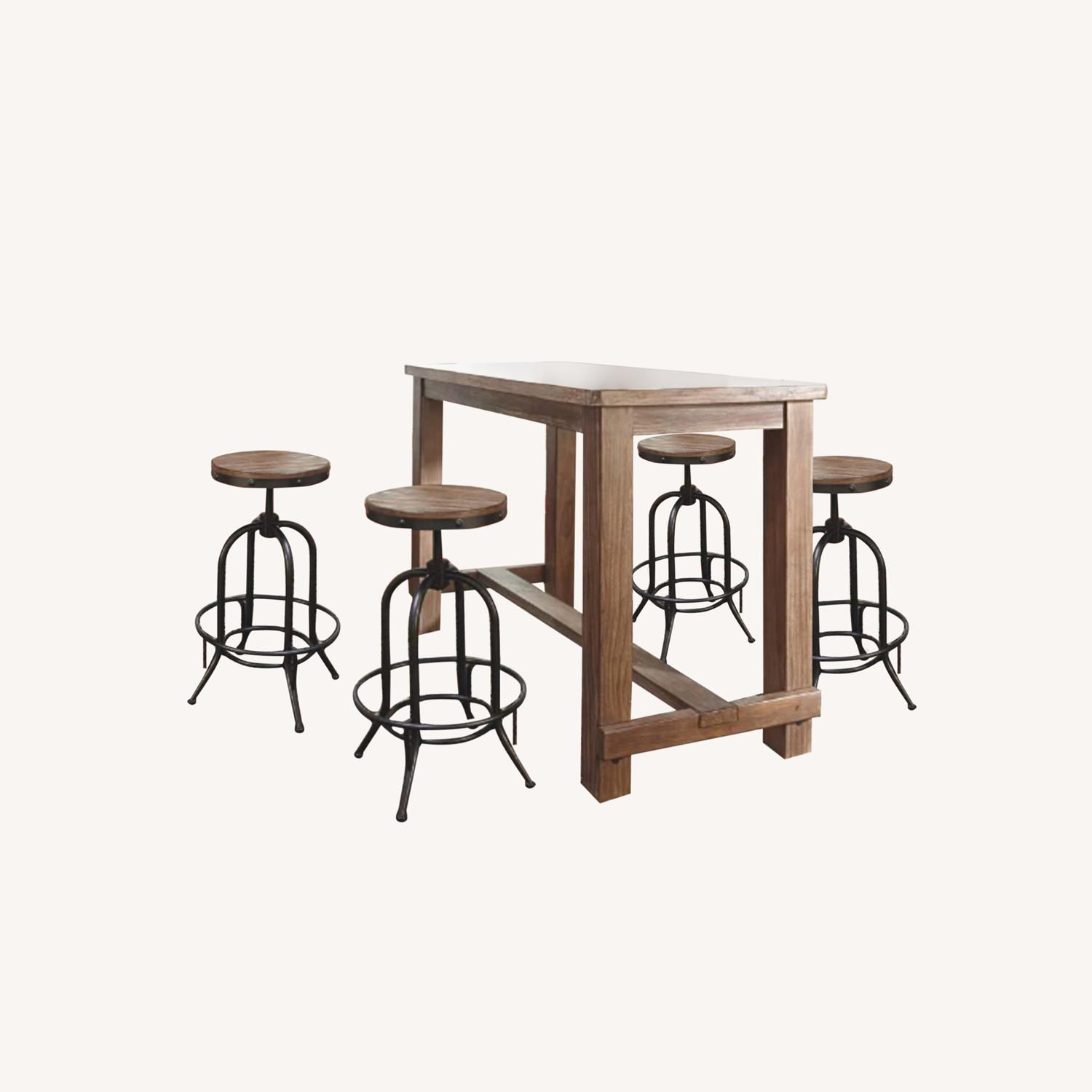 Ashley Furniture Dining Room Bar Table and Bar Stools (4) - image-0