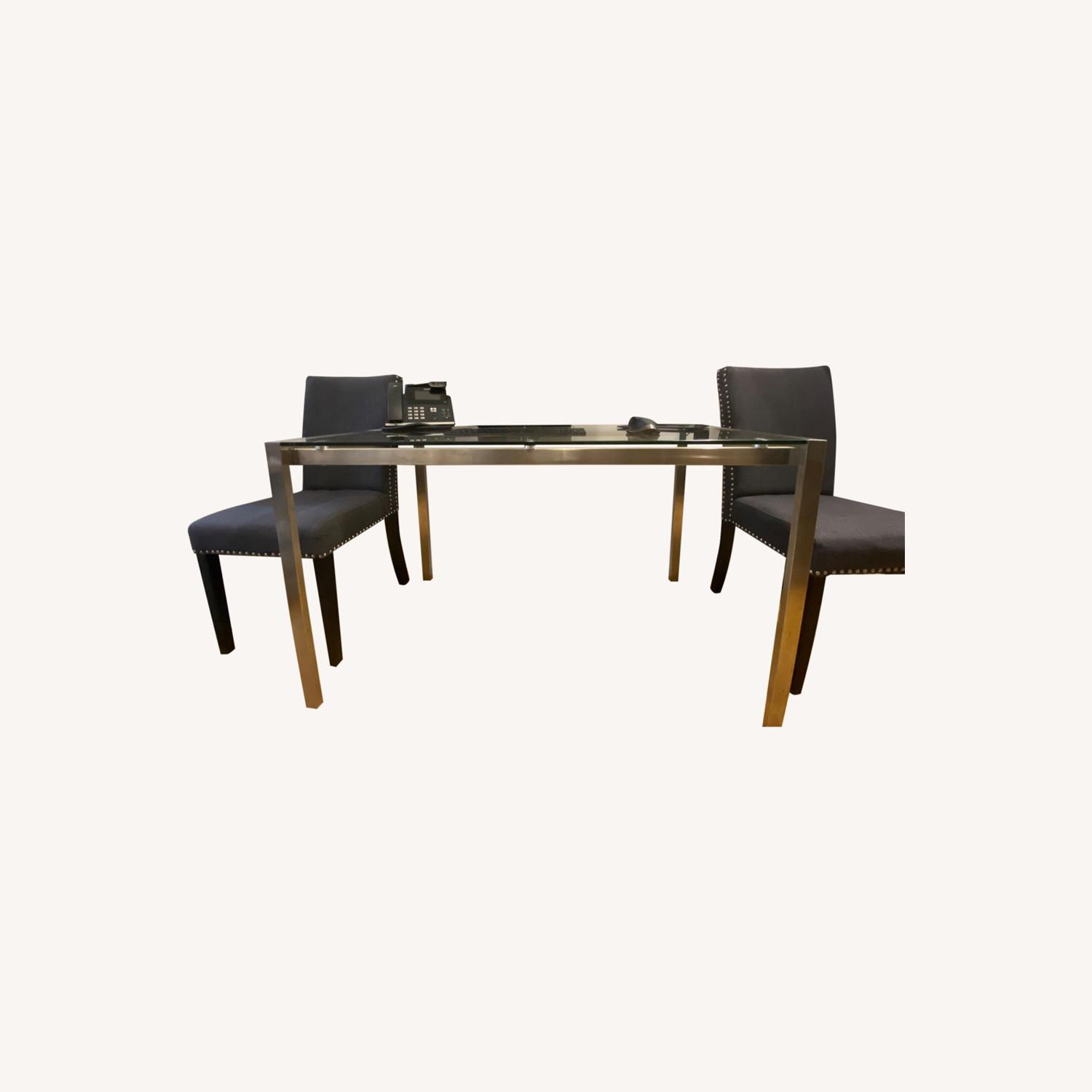 Baxton Studio Glass Desk or Dining Table w 2 Gray Chairs - image-0