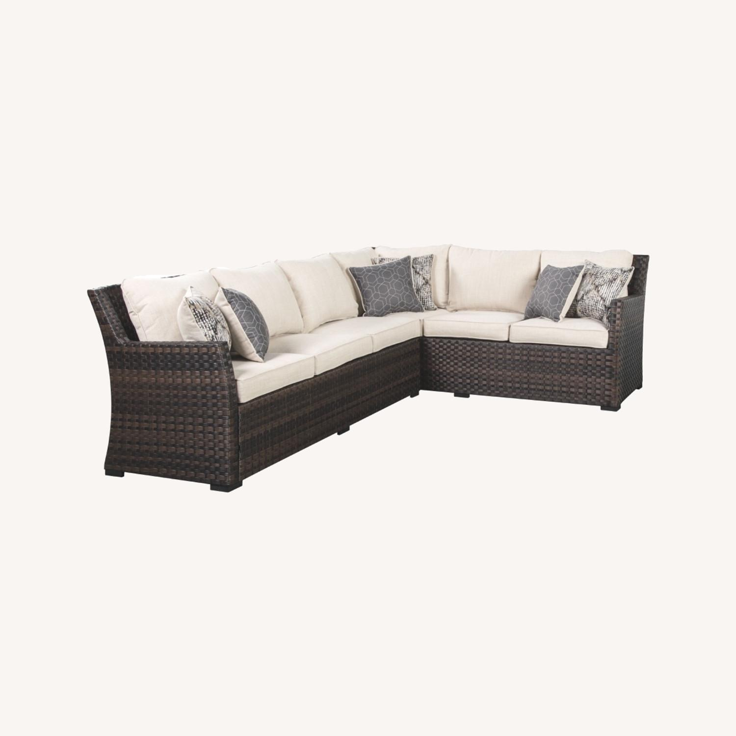 Ashley Furniture Resin Wicker Sectional - image-0
