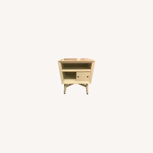 Used Dwell Studio Wood Mid Century Bedside Table for sale on AptDeco