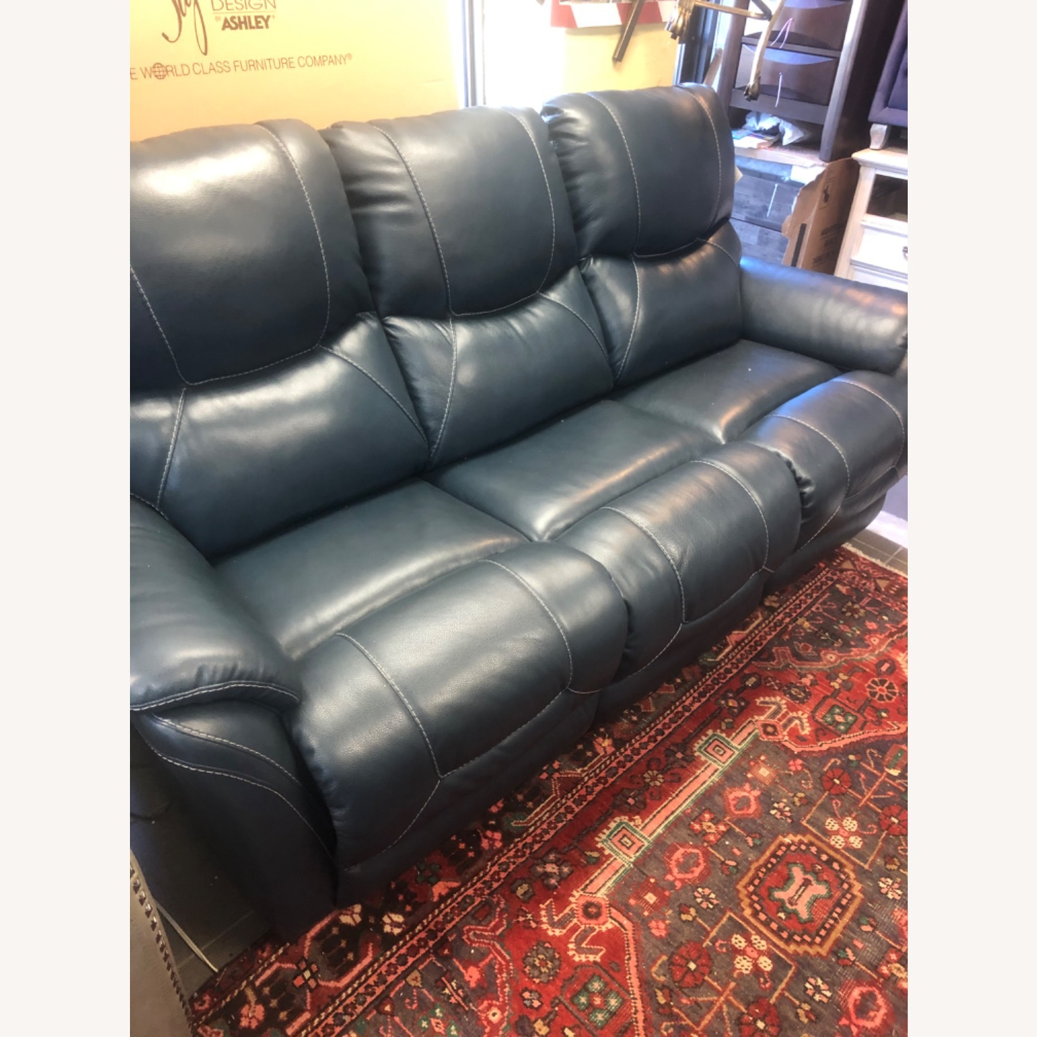 Ashley Furniture Genuine Leather Power Reclining Sofa - image-2