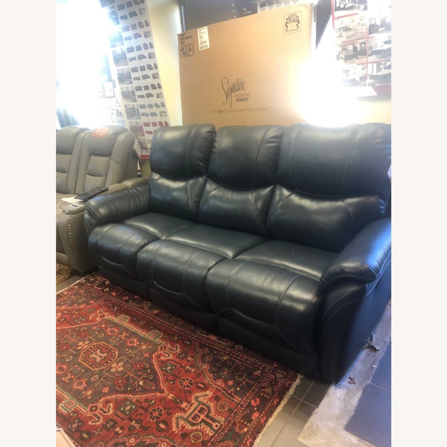 Ashley Furniture Genuine Leather Power Reclining Sofa - image-4