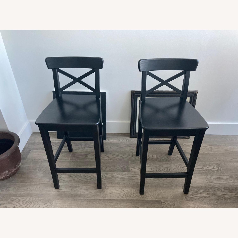 IKEA 2 Black Wooden Bar Stools - image-1