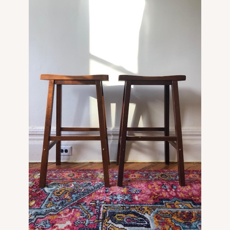 IKEA Dark Wood Saddle Stools - image-1