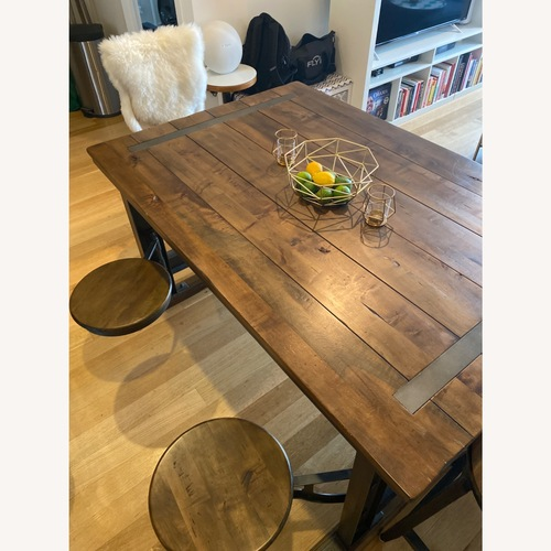 Used World Market Charming Galvin Cafeteria Table for sale on AptDeco