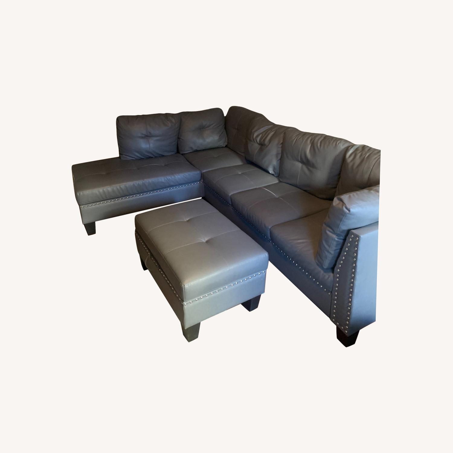 Wayfair Blue Sectional with Storage Ottoman - image-0