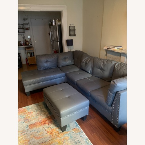 Used Wayfair Blue Sectional with Storage Ottoman for sale on AptDeco