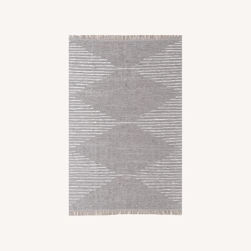 Used Urban Outfitters NWT all Cotten 5x7 Area Rug for sale on AptDeco
