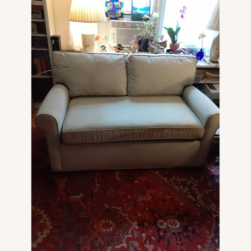 Used Carlyle convertible love seat for sale on AptDeco