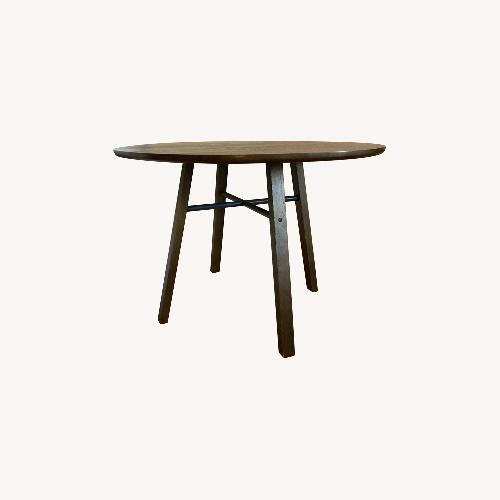 Used Crate & Barrel Circular Dinning Table for sale on AptDeco