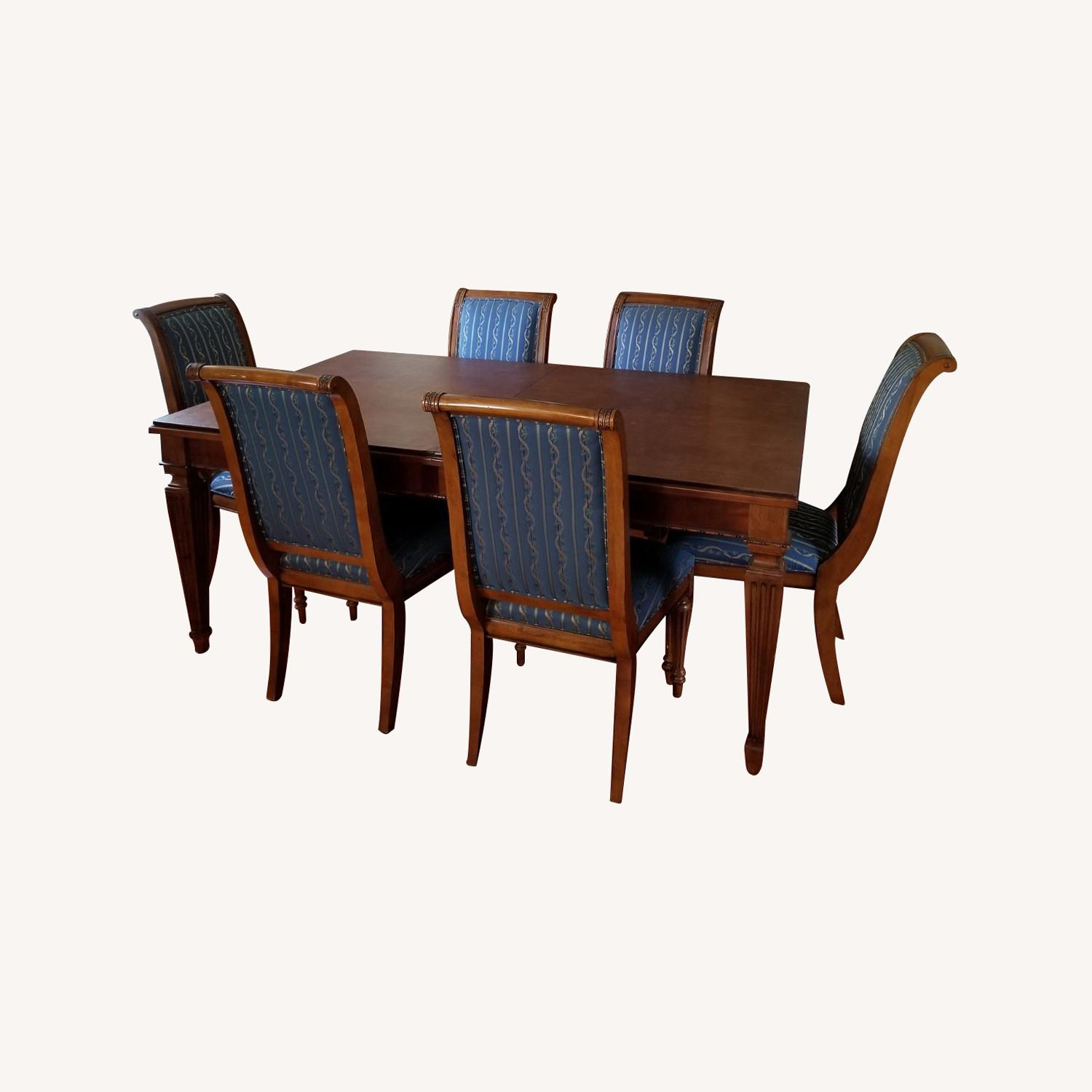 Ethan Allen Dinning Room Set w/8 chairs - image-0