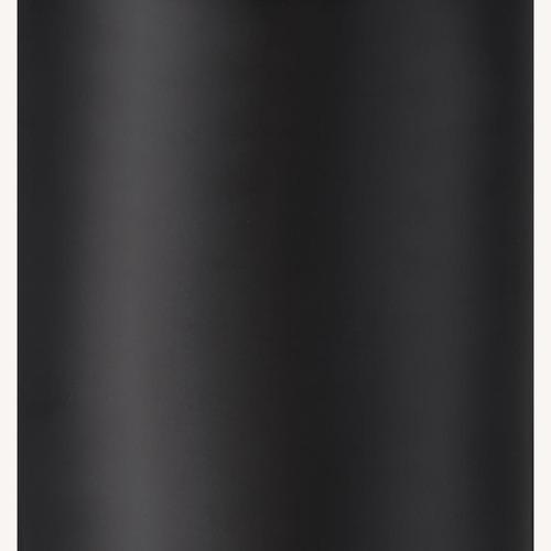 Used Coat Rack In Black Metal W/ Hourglass Silhouette for sale on AptDeco
