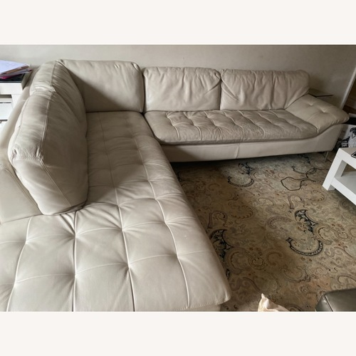 Used Chateau Dax Leather Sectional for sale on AptDeco