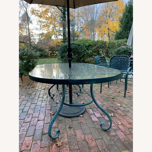 Used Large Oval Patio Table with Umbrella for sale on AptDeco