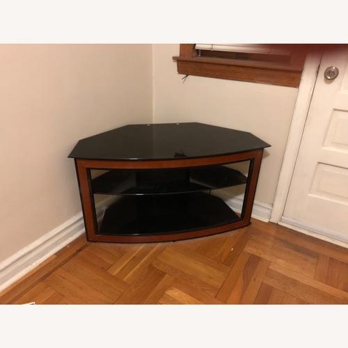 Used BellO corner TV stand for sale on AptDeco