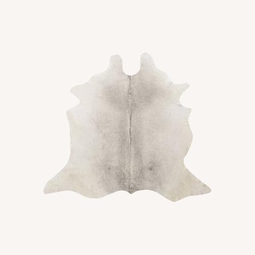 Used CB2 Grey Cowhide Rug for sale on AptDeco