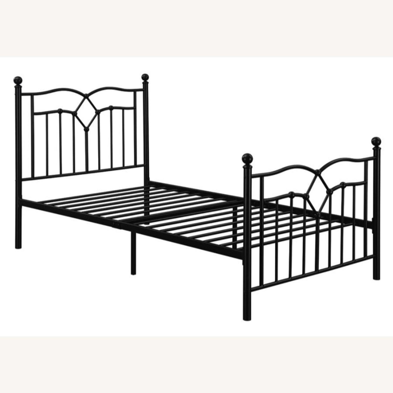 Twin Bed Constructed In Black Metal Steel Tubing - image-0