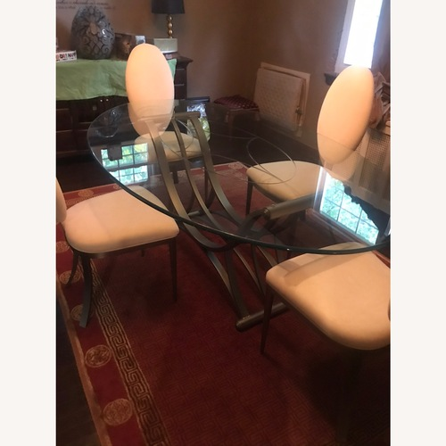 Used Contemporary Glass and Brushed Nickel Dining Set for sale on AptDeco