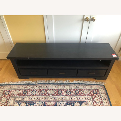 Used Nadeau Solid Wood Black TV Stand for sale on AptDeco