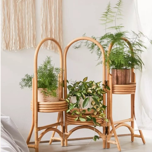 Used Urban Outfitters 3-Tier Rattan Plant Stand for sale on AptDeco