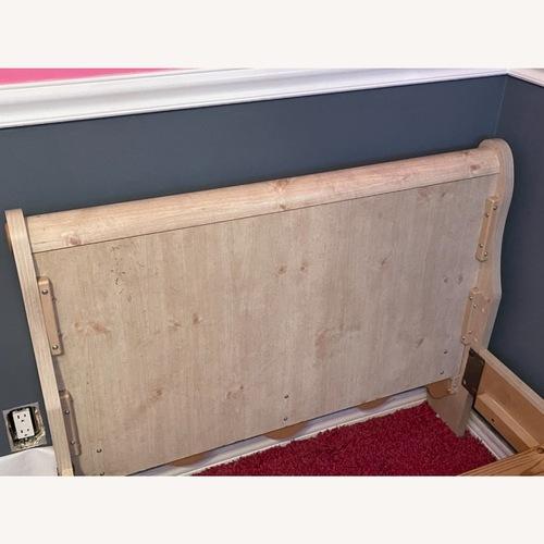 Used Raymour & Flanigan Twin Sleigh Bed for sale on AptDeco