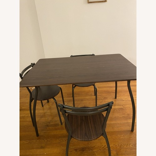 Used Brown Dining Table with 4 Chairs for sale on AptDeco