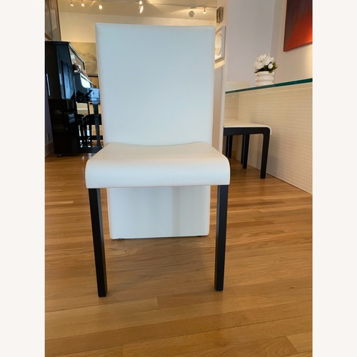Used Luxury Italian Poltrona Dining Chairs for sale on AptDeco