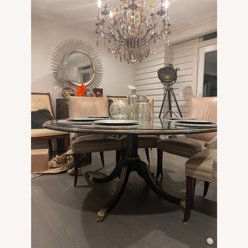 Used Lillian August Round mirror and wood dining table for sale on AptDeco