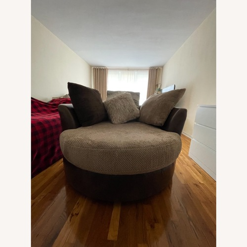 Used Two-tone Brown Swivel Chair for sale on AptDeco