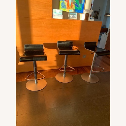Used Ligne Roset 3 Black and Metal Bar Stools for sale on AptDeco