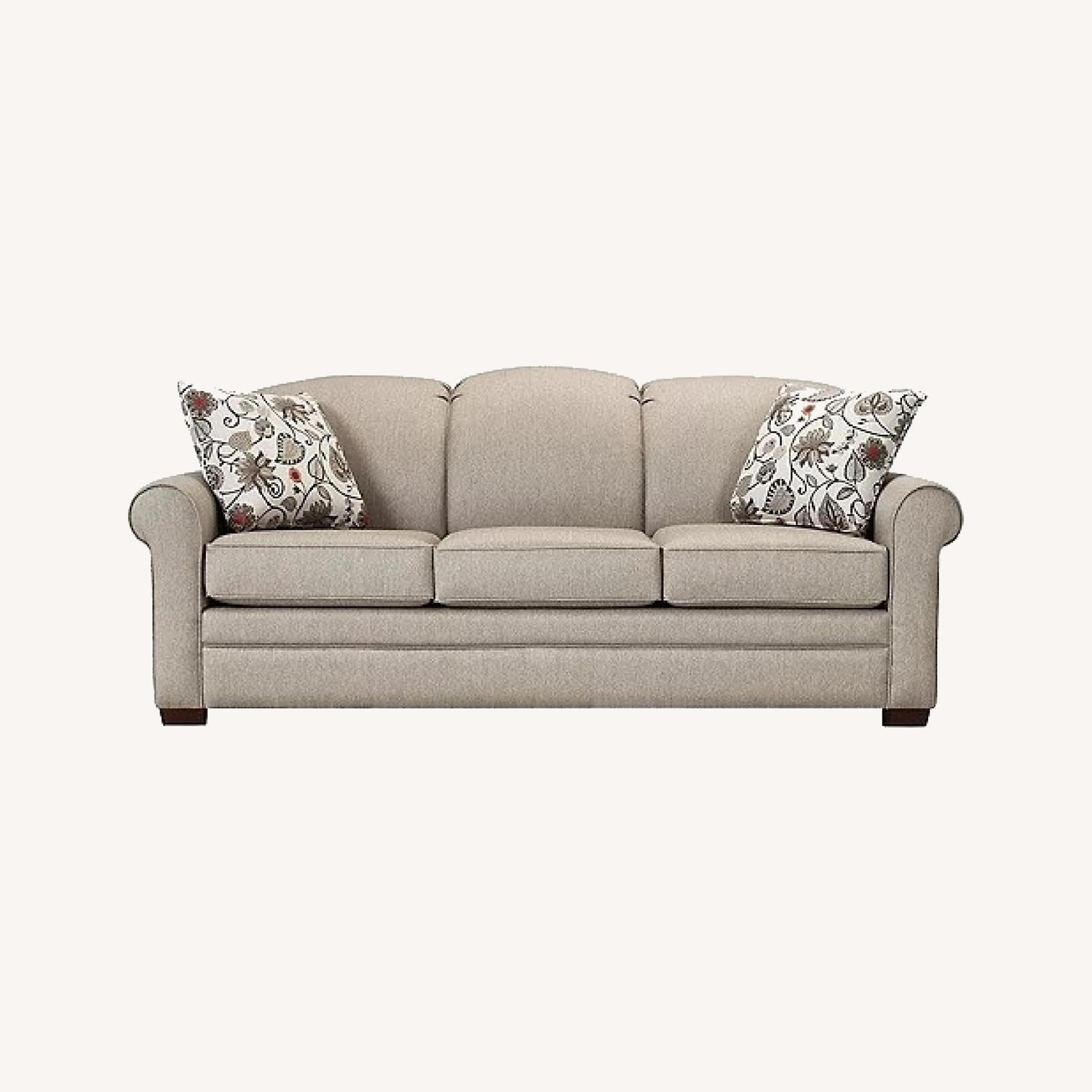Raymour & Flanigan Green Couch with Reversible Pillows - image-0