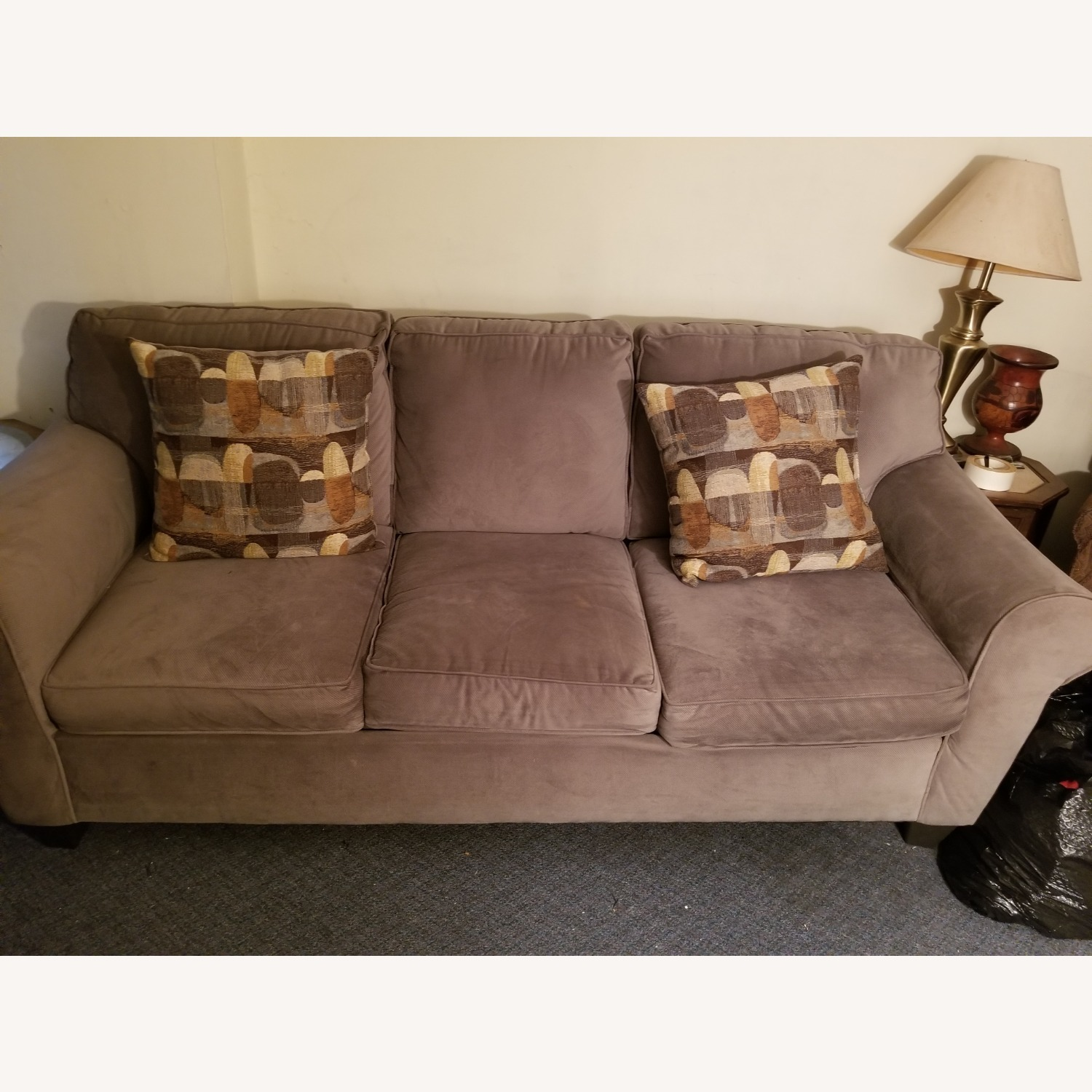 Raymour & Flanigan Green Couch with Reversible Pillows - image-1