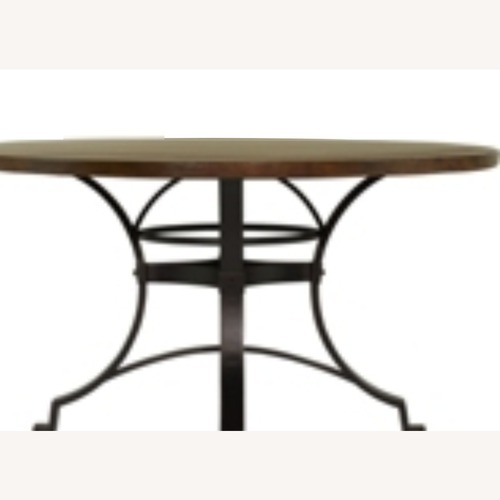 Used Copper Canyon Dining Table for sale on AptDeco