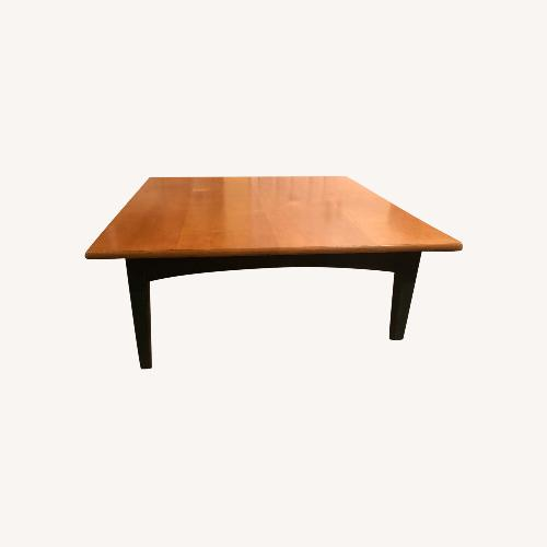 Used Distressed Square Oak Coffee Table with Green Trim for sale on AptDeco