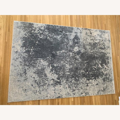 Used Surya Aberdine Area Rug (7.6x5.2) - Grey/Silver for sale on AptDeco