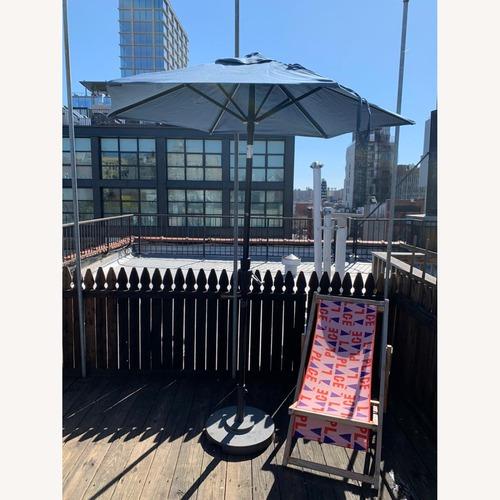 Used Crate & Barrel Outdoor Umbrella + Base for sale on AptDeco