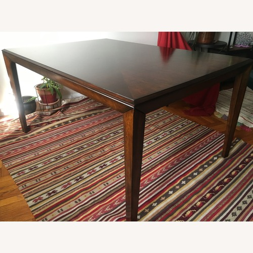 Used The Door Store Dining Table for sale on AptDeco