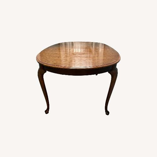 Used Thomasville Extendable Solid Wood Dining Table for sale on AptDeco