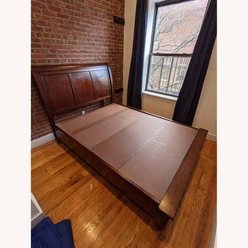 Used Aspen Home Queen Sleigh Bed with Storage Footboard for sale on AptDeco