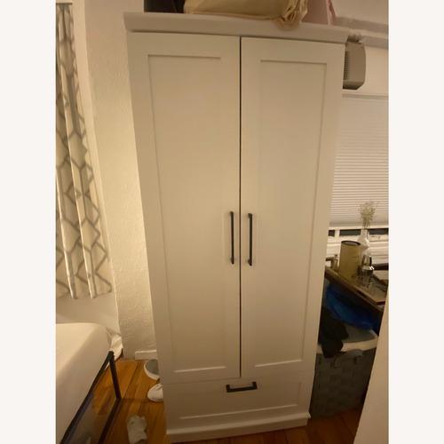 Used Sauder White Wardrobe with Drawer and Shelf for sale on AptDeco
