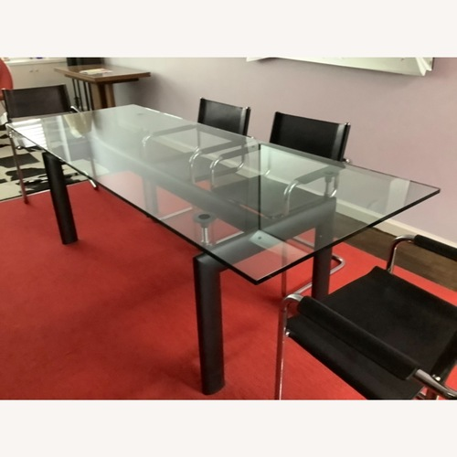 Used Cassina LC6 Dining Room Table for sale on AptDeco