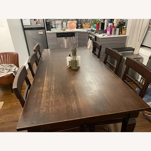 Used Crate & Barrel Wood Dining Table w/ 6 Chairs for sale on AptDeco