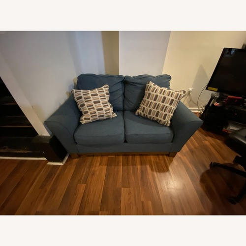 Used Blue Loveseat with Original Accent Pillows for sale on AptDeco
