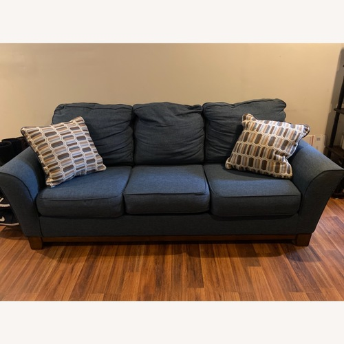 Used Blue Sofa with Original Accent Pillows for sale on AptDeco
