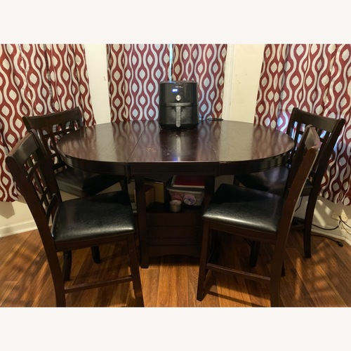 Used 5 Piece Dining Set w/ Storage cube for sale on AptDeco