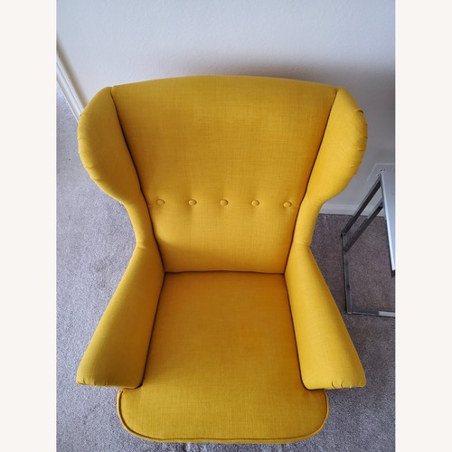 Used IKEA STRANDMON Wing Chair with Ottoman for sale on AptDeco