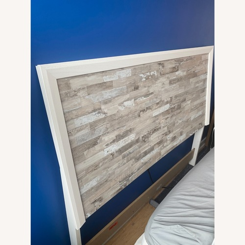 Used Ashley Furniture Queen/Full Panel White Headboard for sale on AptDeco