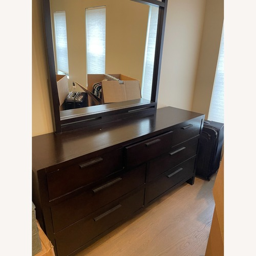 Used Macy's Tribeca 7 Drawer Dresser with Mirror for sale on AptDeco