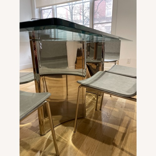 Used Glass Dining Table with Chairs for sale on AptDeco